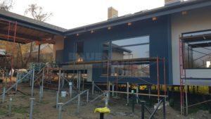комбинированный фасад дома из СИП панелей фото